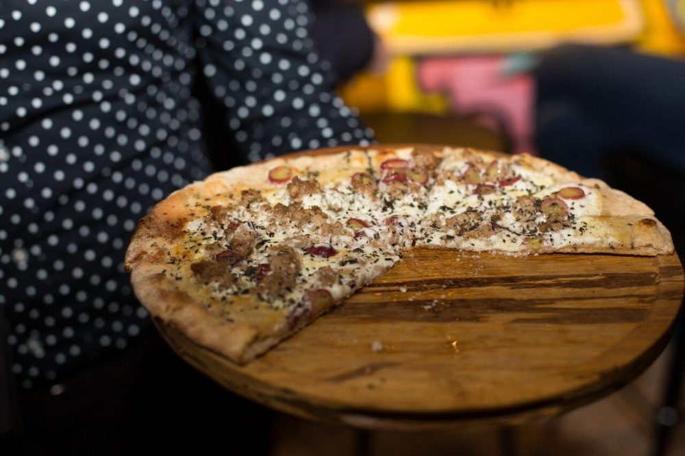 Wicker Park Pizza: fresh goat cheese, housemade Italian sausage and red grapes.