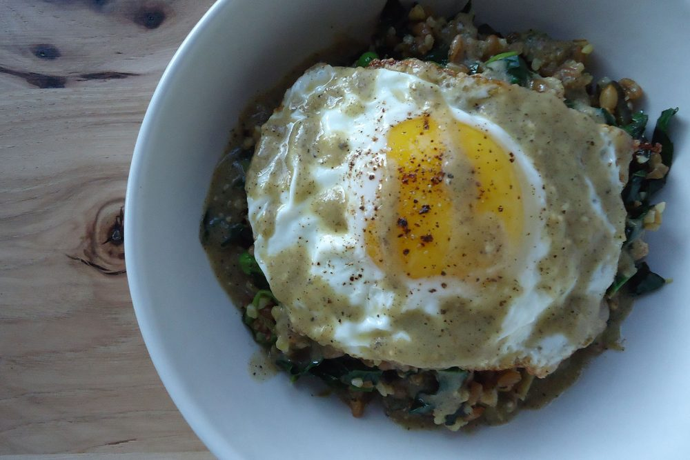 Warm grain salad shishito pepper, kale, tomatillo, sunny egg