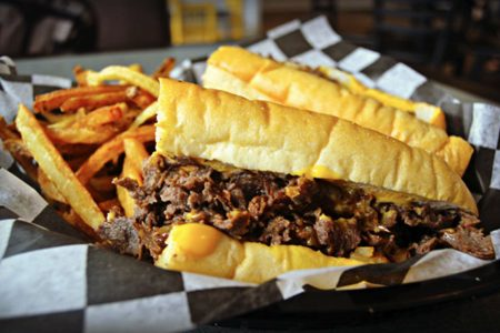 Celebrate National Cheesesteak Day at Mojo's East Coast Eats