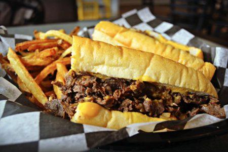 Celebrate National Cheesesteak Day at Mojo's East Coast Eats