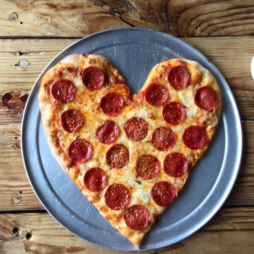heart shaped pizza at the local pizzeria for valentines