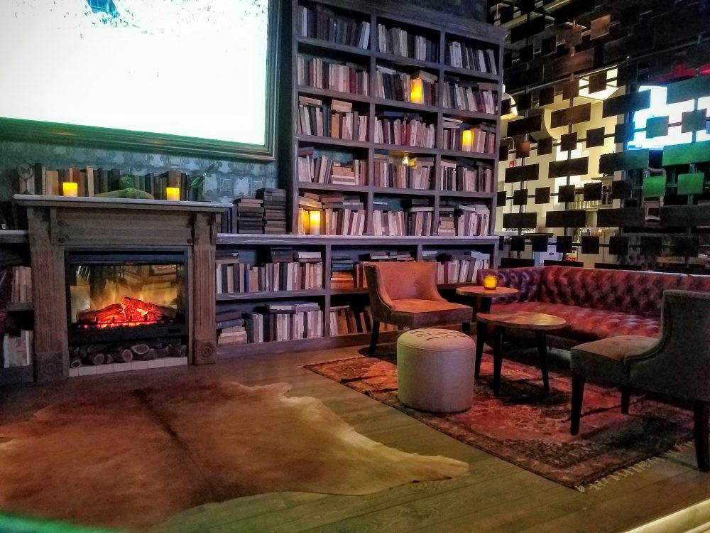 The cozy library perfect for sipping whiskey in front of the faux fire and very real large screen TV.