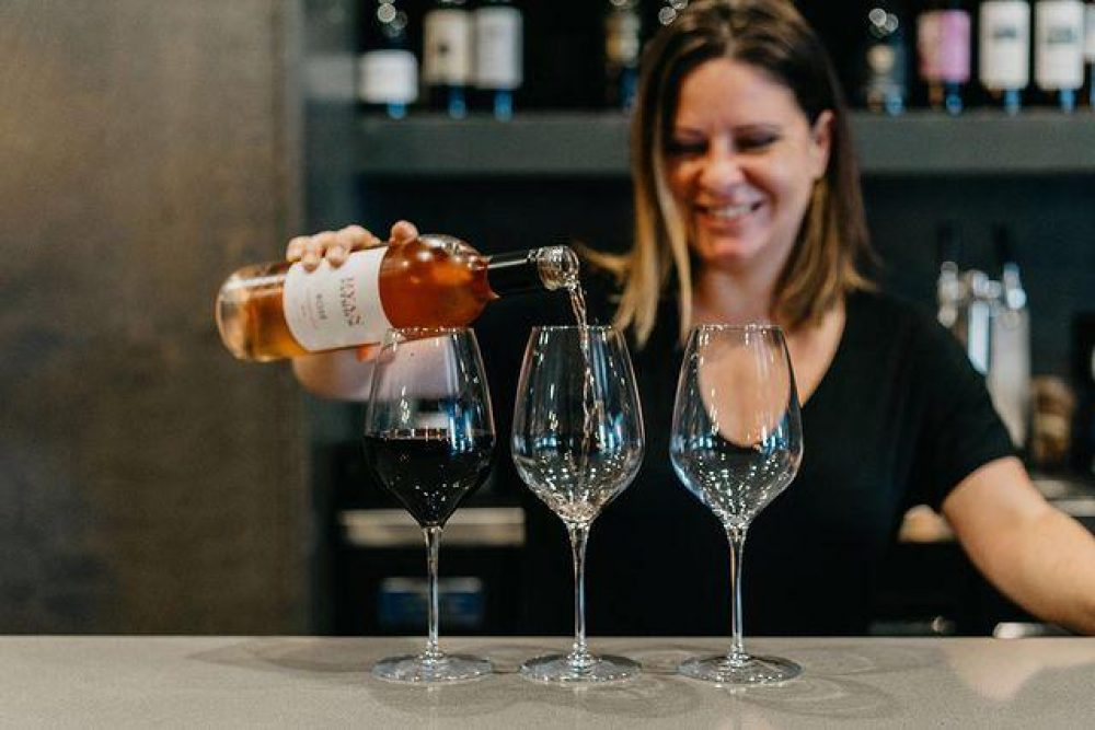 Uvae Owner Lindsey Anderson Wine Pour 1