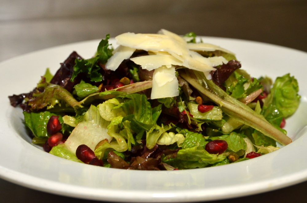 Mixed Green Salad with Pumpkin Seeds, Parmesan, and Pomegranate and Balsamic Dressing